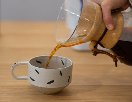Serving freshly brewed pour over in a cup