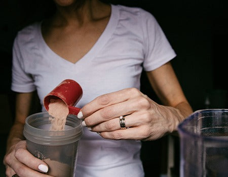 Adding protein shake and Rage Coffee in a blender