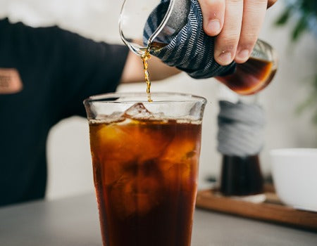 Pouring coffee over the ice