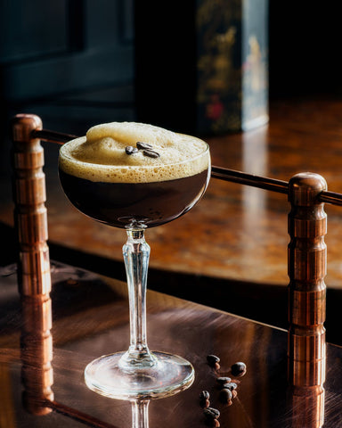 A glass filled with coffee martini