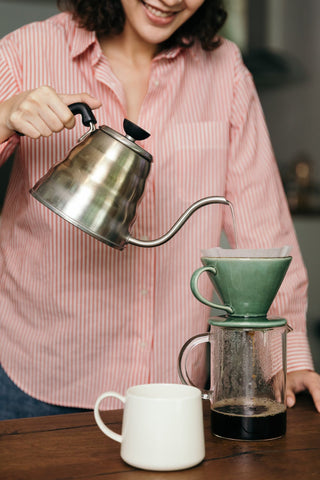 Pouring water to make filter coffee