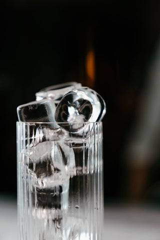 A glass filled with ice cubes