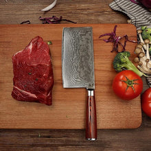 Load image into Gallery viewer, Masuta Knife Imports Gamma Cleaver knife laying on a bamboo cutting board with a large piece of raw beef and some vegetables