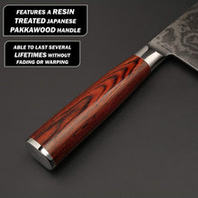 Load image into Gallery viewer, Showing the resin treated Japanese pakkawood handle over a grey cutting surface