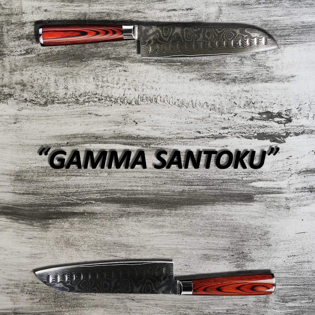 two santoku knives laying opposite from each other on a grey wood cutting board