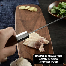 Load image into Gallery viewer, professional chef holding carbon heart kiritsuke knife and cutting meat on cutting board