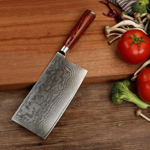 Gamma blade leaning over wood cutting board with chopped vegetables