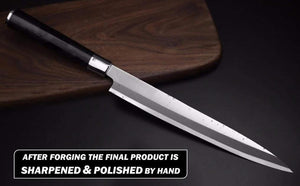 Yanagiba leaning on a dark wood cutting blade displaying the hand polished and sharpened finish on the blade profile