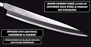 Veneer micro folded layers of stainless steel being displayed on the 426mm yanagiba blade