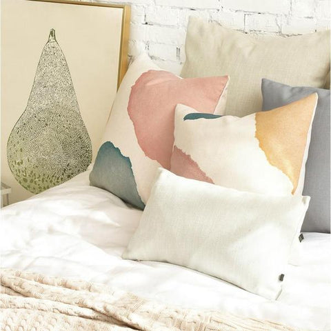 Photograph of cushion covers with marble prints in pastel pink and blue colours