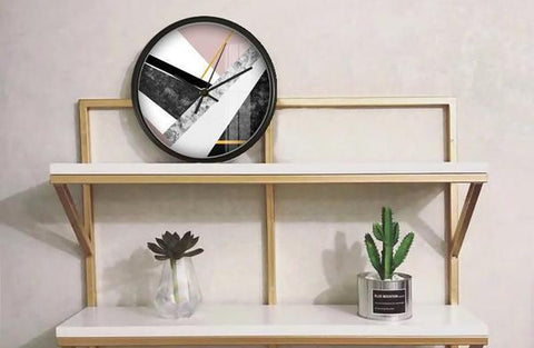 A wall clock with geometric pattern on its dial