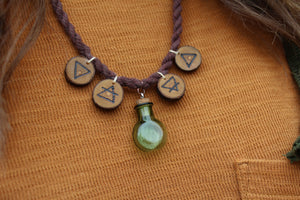 SPELL BOTTLE - ELEMENTAL MAGIC Glass Bottle Necklace with Handmade Wooden Charms.