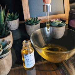 hair serum and oil in a bowl