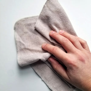Paperless towels in use with hand