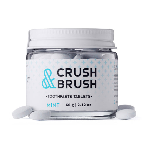 a glass jar of Crush & Brush mint toothpaste tablets