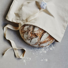 Load image into Gallery viewer, Dans Le Sac natural cotton bread bag with a round bread loaf sticking out