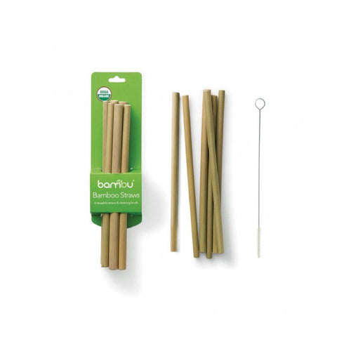 Green package of bamboo drinking straws next to 6 loose bamboo drinking straws and a straw cleaning brush