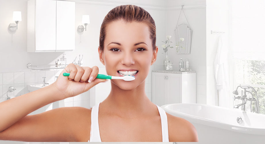 Person brushing her teeth.