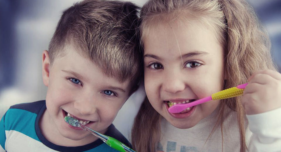 Kids brushing their teeth.