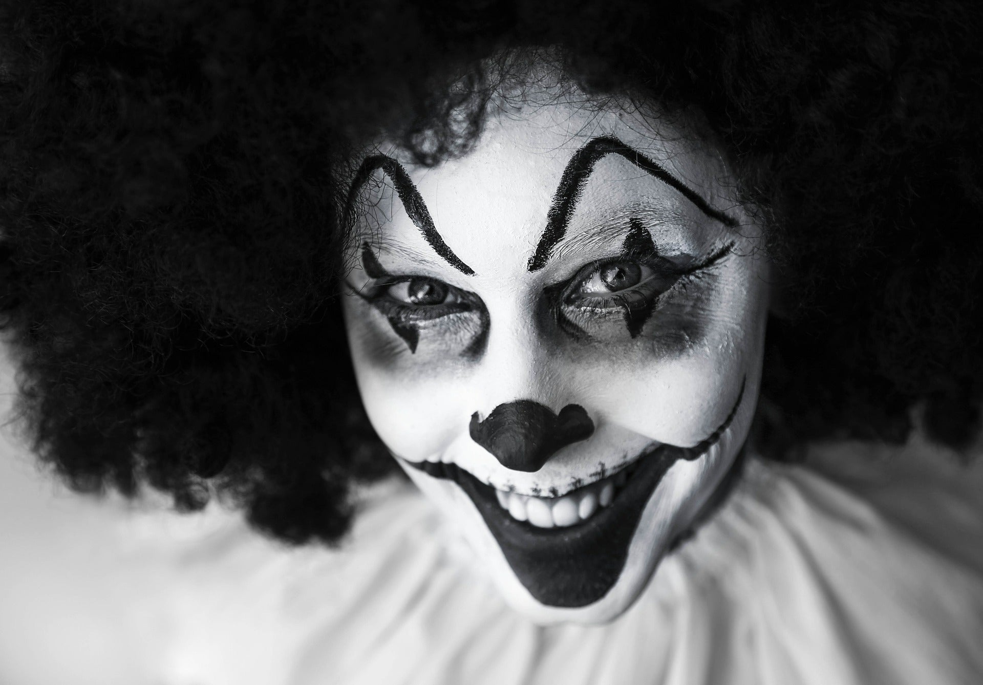 Black and white image of a creepy grinning clown, for AutoBrush