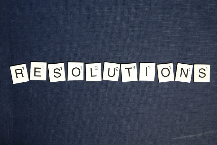 "Scrabble tiles spelling out ""Resolutions"", for AutoBrush"