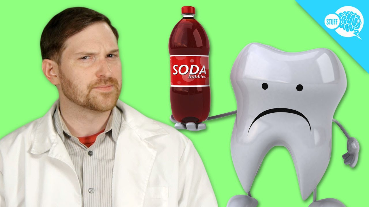 Man in lab coat with cartoon tooth holding a bottle of soda, for AutoBrush blog