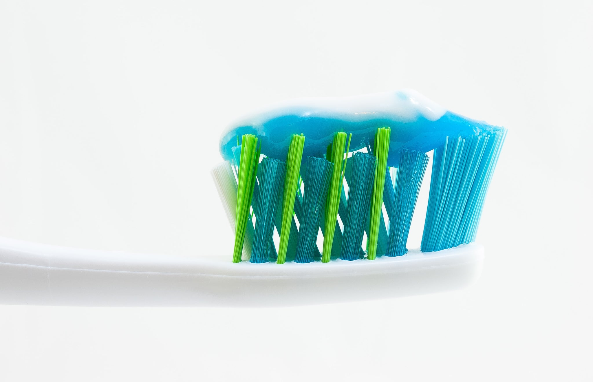 Toothbrush with toothpaste on white background, for Autobrush
