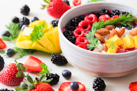 Bowl of fruits and berries surrounded by other berries, for AutoBrush blog