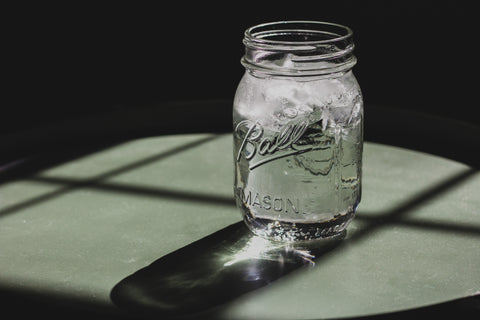 Glass mason jar filled with iced water, for AutoBrush blog