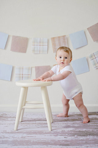 Toddler holding a white stool, for AutoBrush