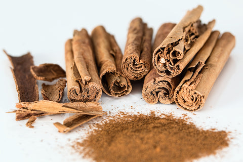 Cinnamon sticks and powder on a white background, for AutoBrush