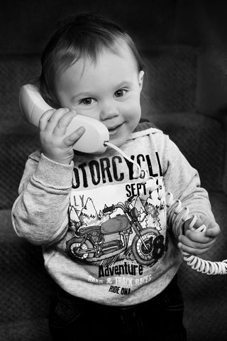 A small child talking on the telephone, for AutoBrush