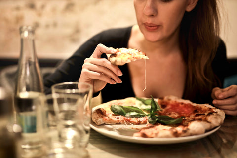 Woman getting ready to eat a slice of pizza, for AutoBrush