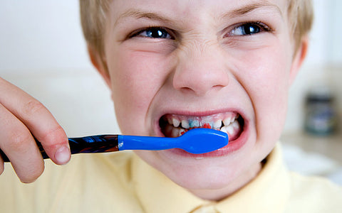 Little boy brushing his teeth with a blue toothbrush, for AutoBrush