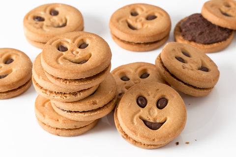 Round chocolate filled cookies with happy faces, for AutoBrush