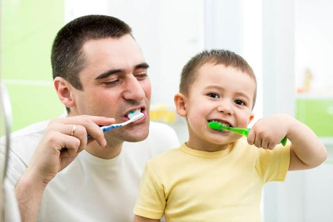 A father brushing teeth with his child, for AutoBrush