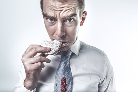 Man eating a strawberry filled donut, for AutoBrush