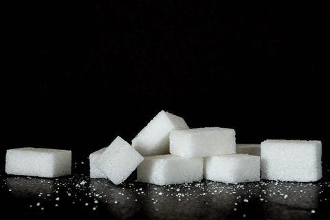 Image of sugar cubes on a black background, for AutoBrush