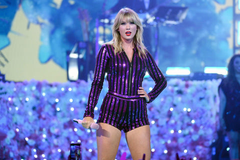 Taylor Swift performing in a striped outfit, for AutoBrush