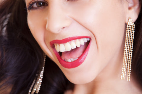 Smiling woman with red lipstick and wearing earrings, for AutoBrush