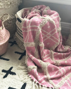 Pink throw styled in basket
