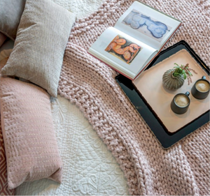 styled bed scene with blush pink accents