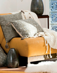 Chunky knit throw styled on yellow chair