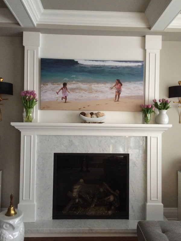 Fireplace with large canvas art above