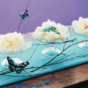 Decorative glass platters with branches and butterfly
