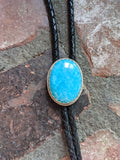 Vibrant Teal Blue Stone and Black Leather Bolo Tie