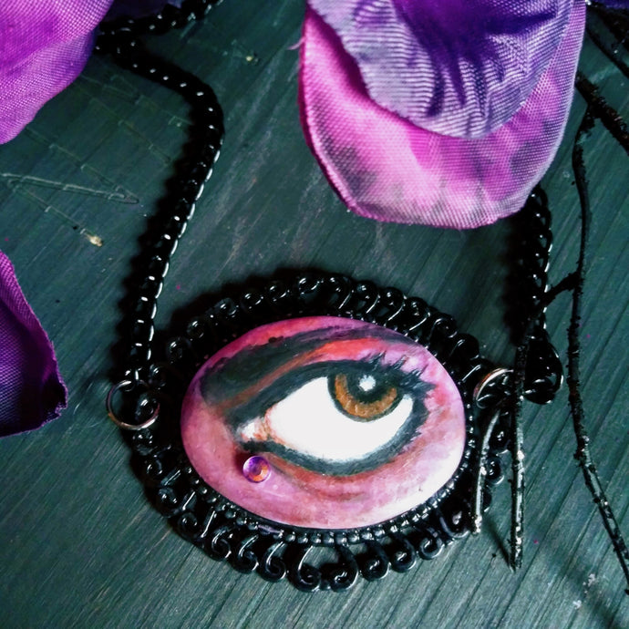 Wanna B Prince's Lover's Eye necklace, hand painted on clay