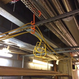 tidi-hanger triple safety hook being used to hang temporary festoon lighting on a construction site