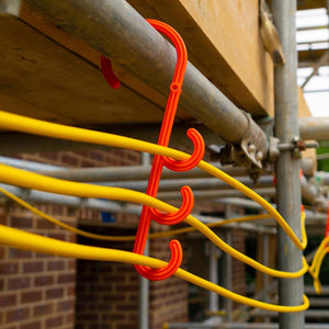 Tidi-Hanger triple safey hook hung over scaffolding to carry temporary extension cords