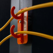 Load image into Gallery viewer, Tidi-Patch Magnetic fixed to a steel column to elevate temporary extension cords